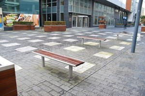 Photo of outdoor space with a coloured paving in a pattern