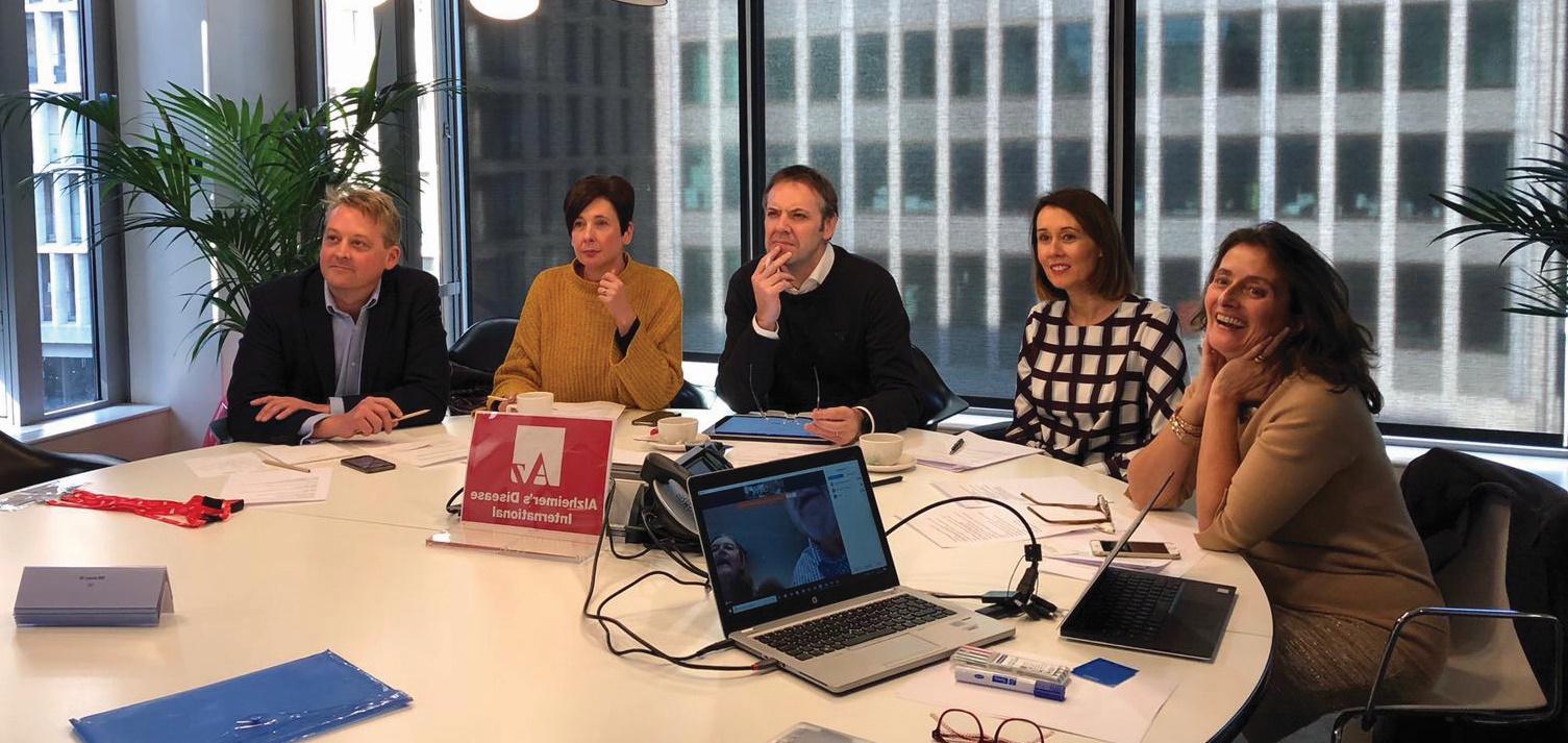 Webinar panelists around a table